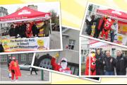 Weihnachtsman, IG BAU und Reinigungskräfte informieren vor dem Chempark Leverkusen.