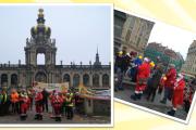 Dresdner Öffentlichkeit wird informiert – Kollegen der Gebäudereinigung spielen IG BAU Weihnachts-Hit in Dauerschleife
