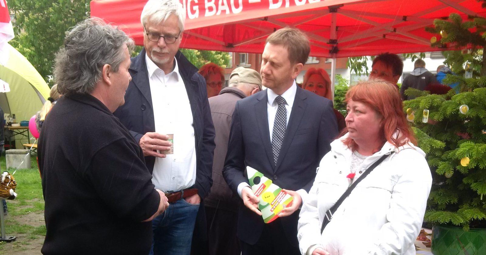 1.Mai in Dresden: Sachsens Ministerpräsident Kretschmer informiert sich zur Lage der Gebäudereiniger